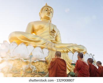 Krabi province, Thailand CIRCA 2019. Buddhist monks praying in front of Buddha statue on top of Tiger Cave Temple Wat Tham Suea