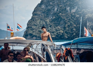 Krabi / Thailand - 25th of Jenuary 2018.  Travel around islands near by Krabi group of touris with local guide. Speed boat and thai sailor.