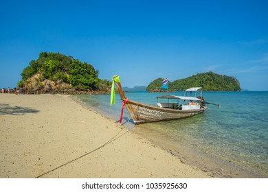 KRABI THAILAND 3 FEB 2018: Longtail boats anchored at the Island in Krabi Province Thailand. Phi Phi is part of Mu Ko Phi Phi National Park.