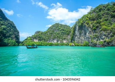 KRABI THAILAND 3 FEB 2018: Longtail boats and speed boats in the sea near Hong island in Krabi Province Thailand. Phi Phi is part of Mu Ko Phi Phi National Park.