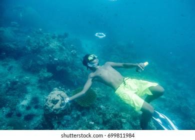 Krabi, Thailand - Apr 05 2017 : Man scuba diving play bubble in blue ocean