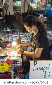 KRABI, THAILAND, April 28, 2017 - Shot of food and Night Market Street in Krabi, Thailand. This is a popular tourist destination. Image contain certain grain or noise and soft focus.