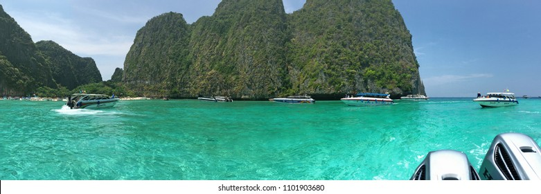 KRABI, THAILAND - APRIL 7, 2018: Speedboats and many tourists at Maya Bay in Phi Phi Island, Krabi Province, Thailand