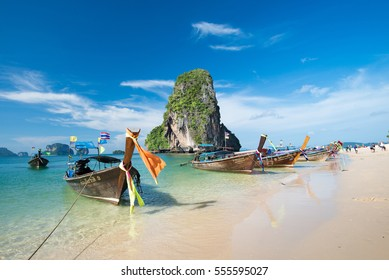 KRABI, THAILAND - DEC 5, 2015: long-tailed boats for tourists are docked along the Phra Nang Cave Beach which is one of the most strikingly beautiful beaches in Thailand
