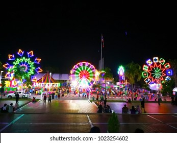 Krabi, Thailand- January 4, 2018: People have a fun time at the funfair, on the grounds in front of Krabi Town Hall. At the Red Cross and The New Year Funfair. Editorial use only.