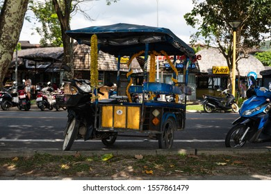 KRABI, THAILAND - JULY 10, 2019. Tuktuk is standing on a road on a street in Krabi. Motorbike taxis are called tuk tuk in Thailand.
