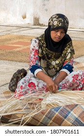 KRABI, THAILAND - July 25, 2016: Thai muslim woman weaving Screw Pine leaves basket.