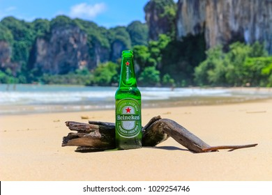 Krabi, Thailand - July 28 2017 green bottle of Heineken lager beer with paradise beach ocean island background