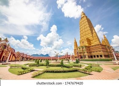KRABI, THAILAND - JUN 1, 2019: Golden Pagoda at Wat Maha That Wachiramongkol temple a popular tourist destination attraction in Krabi Province