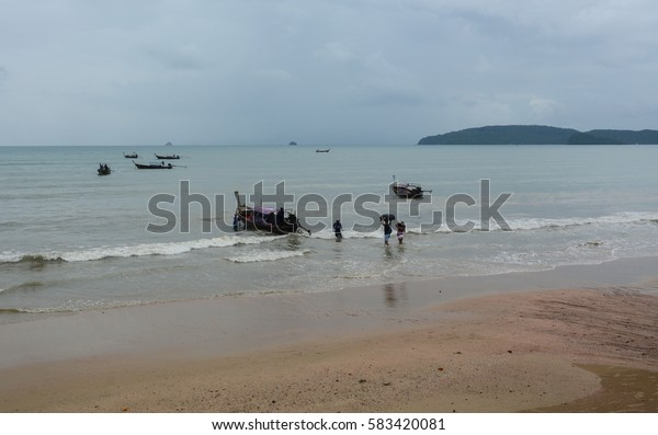 Krabi, Thailand - Jun 21, 2016. People relax on Ao Nang beach in Krabi, southern Thailand. Krabi is the main town in the province of Krabi on the west coast of southern Thailand.