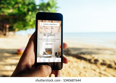 KRABI, THAILAND - MARCH 06, 2018: Closeup of iPhone Screen with AirBNB PLUS Startscreen at a Beach
