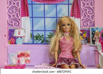 KRABI, THAILAND - MARCH 8: Barbie sitting on sofa chair in the doll house on March 8, 2017 in Krabi, Thailand.