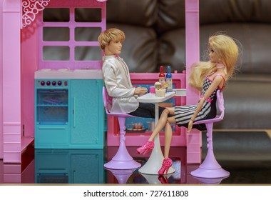 KRABI, THAILAND - MARCH 8: Romantic barbies in love eating food in kitchen room of the doll house on March 8, 2017 in Krabi, Thailand.