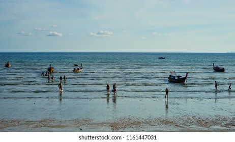 Krabi, Thailand - May 15th 2018: Tourists returning from their long tail boat island hopping in Ao Nang beach.