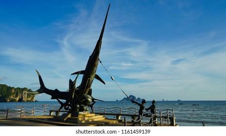 Krabi, Thailand - May 15th 2018: A sculpture of the fishermen catching a sailfish in Ao nang beach.