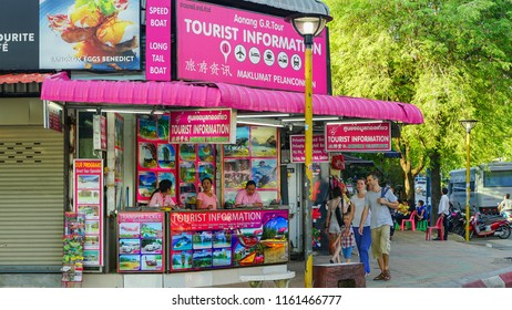 Krabi, Thailand - May 15th 2018: A family visiting Tourist Information in Ao nang beach.