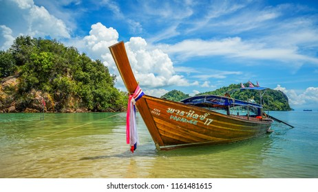 Krabi, Thailand - May 15th 2018: A long tail boat docked at the Koh Pak Bia island while waiting for tourist.
