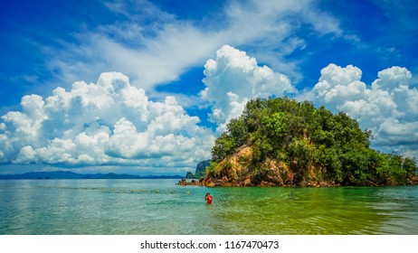 Krabi, Thailand - May 15th 2018: A solo tourist snorkeling in Koh Pak Bia island.