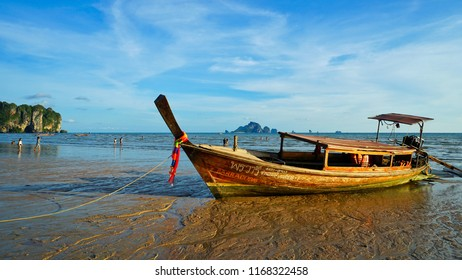 Krabi, Thailand - May 15th 2018: A long tail boat stuck on low tide in Ao Nang beach.