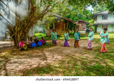 KRABI, THAILAND - MAY 3, 2015: Senior women doing Ronggeng dance while senior men playing music in Lanta island of Krabi, Thailand