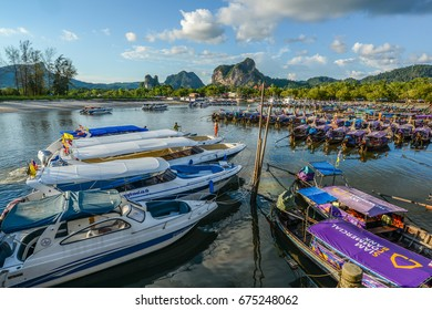 KRABI, THAILAND - MAY 4, 2015: Tourist boats floating on sea of bay to provide transportation service to tourists to go to any other islands nearby Krabi, Thailand.