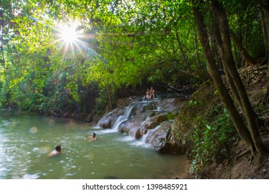 Krabi, Thailand -May 4, 2019: people enjoying a bath at Namtok Ron Hot Spring Waterfall, a natural hot tub.