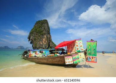 KRABI, THAILAND - MAY 4 : Long-Tailed boat Food and drink vendor at Railay beach with high limestone cliffs on May 4, 2017 in Krabi province, Thailand.