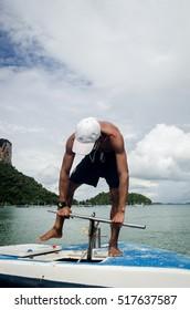 KRABI, THAILAND, NOV 6 : local boatman  dropping an anchor in tourist speed boat on November 2, 2016 Krabi, Thailand