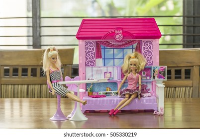 KRABI, THAILAND - OCTOBER 19: Barbies sitting in the doll house on October 19, 2016 in Krabi, Thailand.