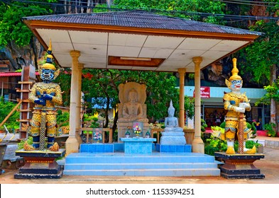 Krabi, Thailand, October 23, 2014: Yaksha statues and Buddha statues at the Wat Tham Sua.