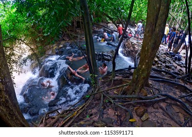 Krabi, Thailand - October 23, 2014: Tourists from all over the world enjoying a bath at Namtok Ron Hot Spring Waterfall, a natural hot tub.