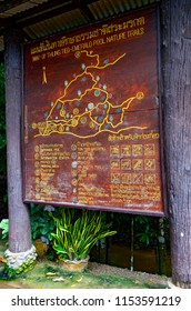 Krabi, Thailand - October 23, 2014: Wooden information sign with a map at the entrance of the area of Sa Morakot, or Emerald Pool.