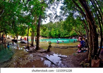 Krabi, Thailand - October 23, 2014: People enjoying a bath in Sa Morakot, also known as Emerald Pool.