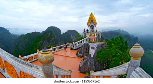 Krabi, Thailand, October 23, 2014: The terrace with orange slabbing at the top of the Wat Tham Sua with the limestone cliffs of Krabi in the background.