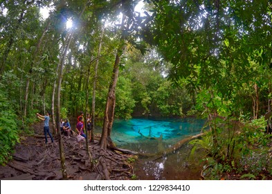 Krabi, Thailand - October 23, 2014: Thai tourists at Blue Pool in the Sa Morakot area, in the Khao Nor Chuchi forest.