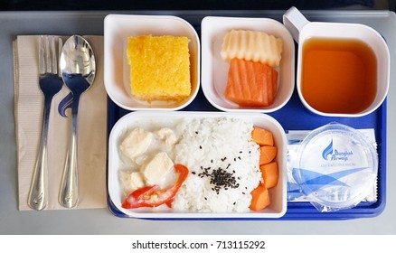 Krabi, Thailand - September 11, 2017 - Inflight meal service by Bangkok Airways, the boutique airline, Airbus A319 (domestic flight from Krabi to Bangkok) Flight PG268, economy class.