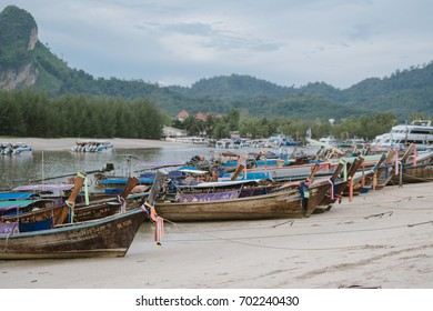 Krabii, Thailand - August 07, 2017 : Fishermen are checking the order of the fishing boats adapted for tourists to see the beauty of the sea.