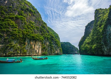 Krabi,Thailand - October 17, 2017 : Taxi boat near A crystal clear turquoise sea in Phi Phi island Andaman sea in Krabi nearby Phuket, Thailand