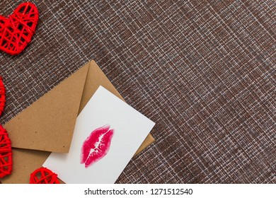 Kraft envelope, hearts and card with a lip print. the concept of Valentine's day