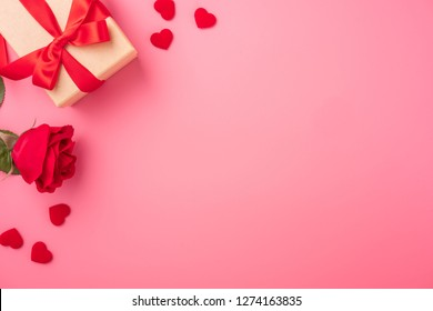 Kraft Gift box with beautful red ribbon and rose, concept of Valentine's, anniversary, mother's day and birthday greeting, copy space, top view.