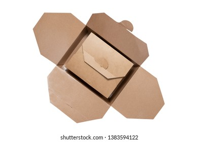 Kraft paper box a smaller one with closed cover laying inside a bigger one  with wide opened cover isolated on white background ,top view. Brown paper boxes with clipping path .