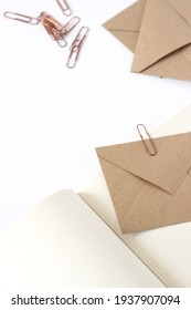 Kraft Paper Envelopes, Stationery on White Background. Minimalist Design Mockup Concept.
