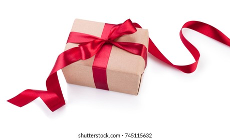 Kraft paper gift box with red ribbon bow from above isolated on white background