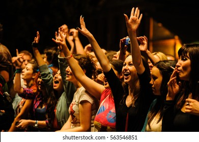 Kragujevac, Arsenal Fest - July 28th: Girl enjoying concert in crowd, cheering with hands in the air