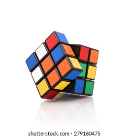 KRAGUJEVAC, SERBIA - APRIL 9, 2015: Rubik's cube on the white background. Rubik's Cube on a white background. Rubik's Cube invented by a Hungarian architect Erno Rubik in 1974.
