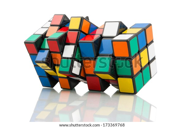 KRAGUJEVAC, SERBIA - JANUARY 14, 2014: Two Rubik's cube making a new shape. Rubik's Cube on a white background. Rubik's Cube invented by a Hungarian architect Erno Rubik in 1974.