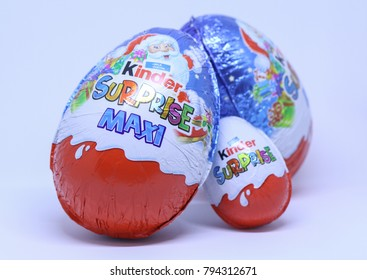 Kragujevac, Serbia - January 7, 2018: Two Maxi Kinder Surprise Eggs and one small Kinder Egg, also known as a Kinder Egg is a brand of Italian confectionery multinational Ferrero S.p.A.