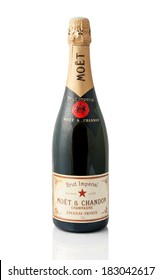 KRAGUJEVAC, SERBIA - MARCH  21, 2014: Bottle of Moet & Chandon champagne on white background.  Moet is a French winery and one of the world's largest champagne producers.
