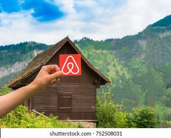 Krakov, Poland. July, 2017: Travel around the world with Airbnb. Logo Airbnb. House on the background.