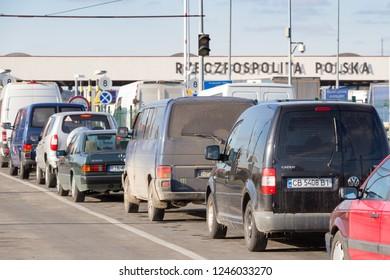 "KRAKOVETS, UKRAINE - NOVEMBER, 2018: Cars waiting to pass through the Ukrainian-Polish border at the checkpoint ""Krakovets-Korchova"", 70 kilometers west of Lviv. Inscription - Poland"
